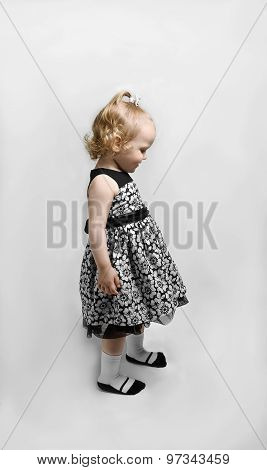 Little Girl In A Black And White Dress