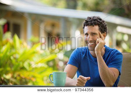Laughing Man Sitting Outdoors