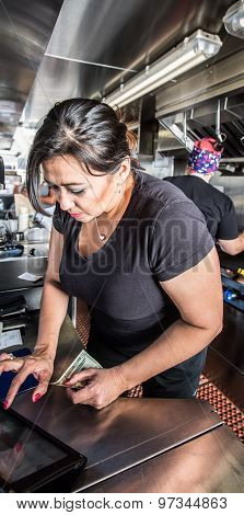 Cashier With Money In Food Truck