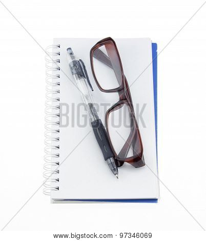 Notebook With A Pair Of Eyeglasses