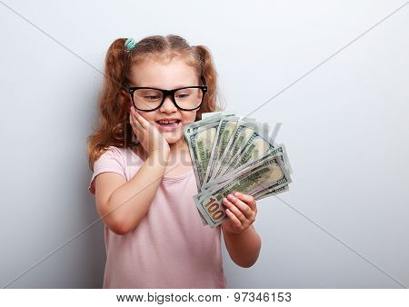 Surprising Emotional Kid Girl Holding Dollars In Hand And Thinking How Much Money She Have Earned