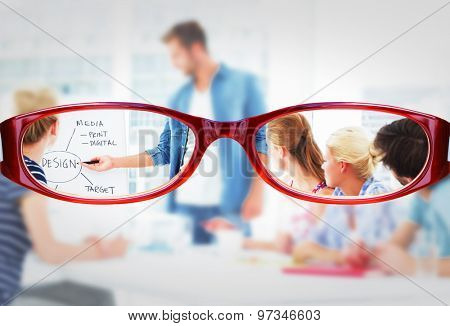 Glasses against casual business people in office at presentation