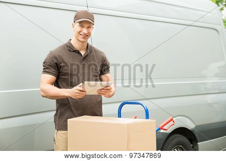 Delivery Man With Digital Tablet And Boxes