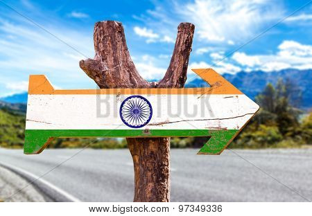 India flag wooden sign with road background