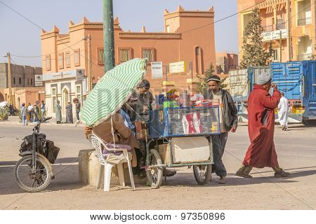 TAZNAKHT,MOROCCO - APRIL 10, 2015: Local street seller offers cigarettes and snacks to buyers