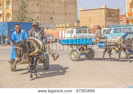 TAZNAKHT,MOROCCO - APRIL 10, 2015: Local men travel on donkey powered cart