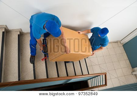 Two Movers With Box On Staircase