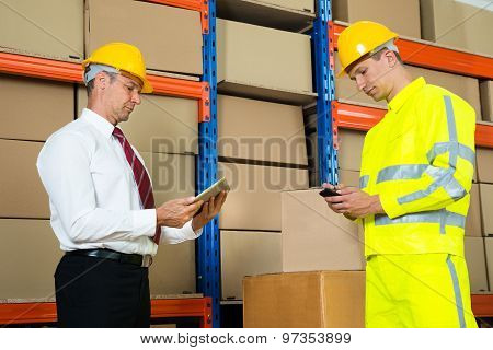 Businessman And Worker With Digital Tablet And Mobile Phone