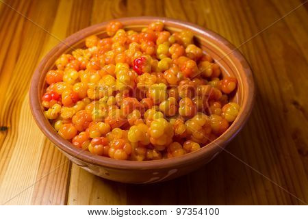 Cloudberries in a clay plate