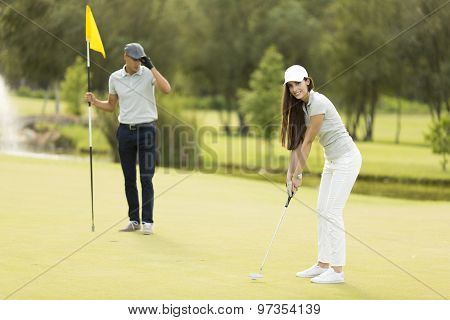 Young Couple At Golf Court