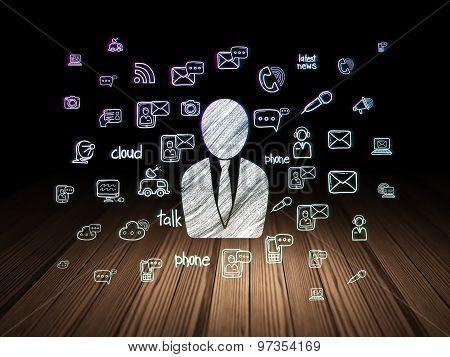 News concept: Business Man in grunge dark room