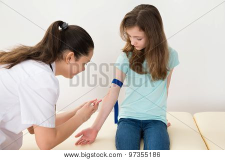 Doctor Taking Blood Sample From Patient