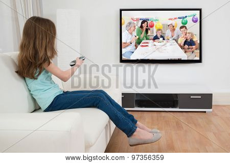 Girl With Remote Control In Front Of Television