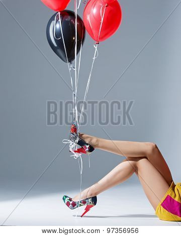 Beautiful Female Legs In Red Shoes And Balloons,