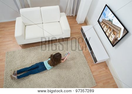 Girl On Carpet Watching Television