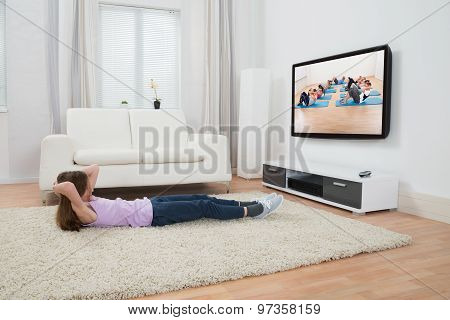 Girl Exercising In Front Of Television