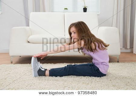 Girl Exercising On Carpet