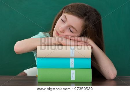 Girl With Books Sleeping At Desk