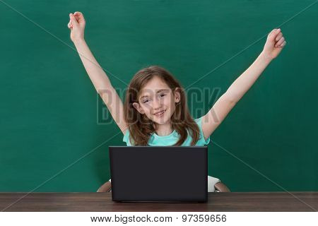 Happy Girl With Laptop In Classroom