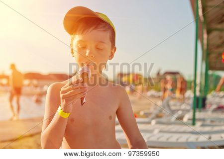 Baby boy with ice-cream at the beach