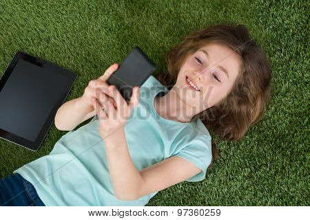 Happy Girl With Digital Tablet And Mobile Phone