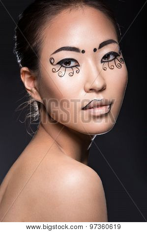 Beautiful Asian girl with a creative makeup, unusual eyelashes paper. Beauty face.