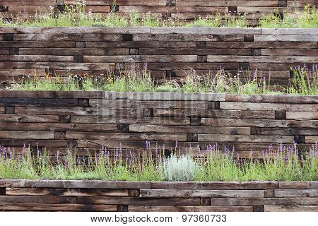 Colorful Railroad Tie Terrace with Wildflowers