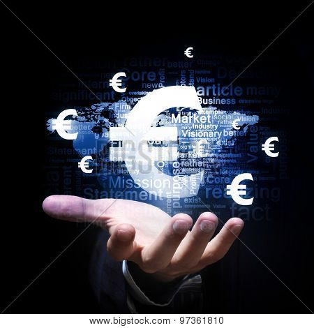 Businessman hand holding euro sign in palm
