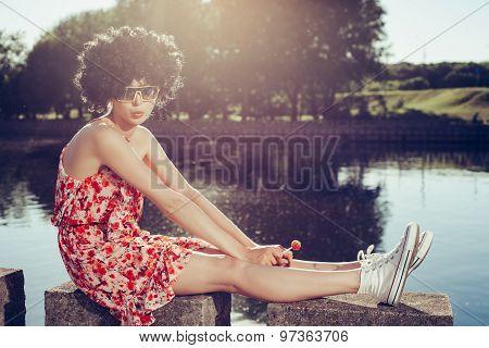 Sexy Girl With Black Wig Hair Sucks Lollipop