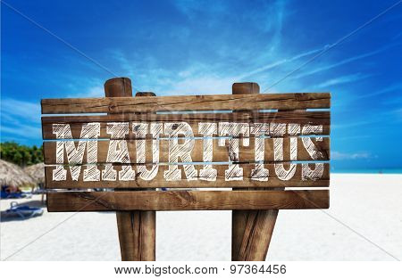 Mauritius wooden sign on the beach
