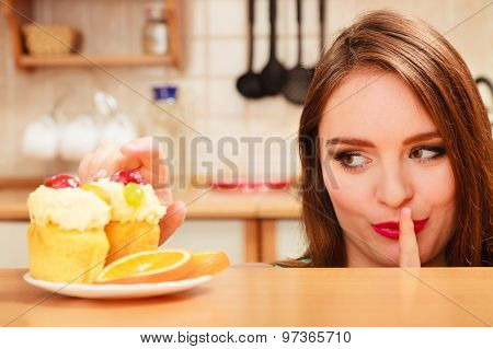 Woman Eating Cake Showing Quiet Sign. Gluttony.