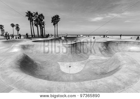 LOS ANGELES, CALIFORNIA, USA - June 20, 2014:  Deep concrete bowl at the popular Venice Beach skateboard park in Los Angeles, California.