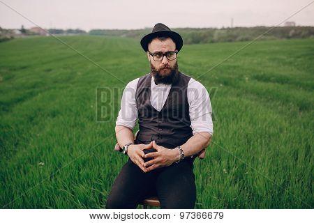 beard man in field lonley
