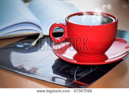 Red Cup Of Coffee On The Desk In The Office