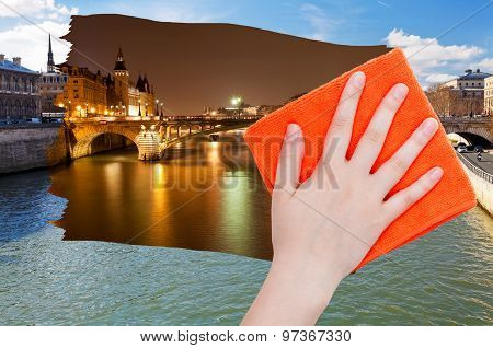 Hand Deletes Day View Of Paris By Orange Cloth