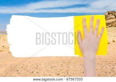 Hand Deletes Sand Of Desert By Yellow Rag
