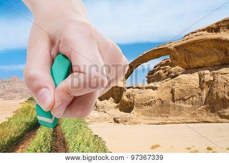Hand Deletes Sand In Desert By Rubber Eraser