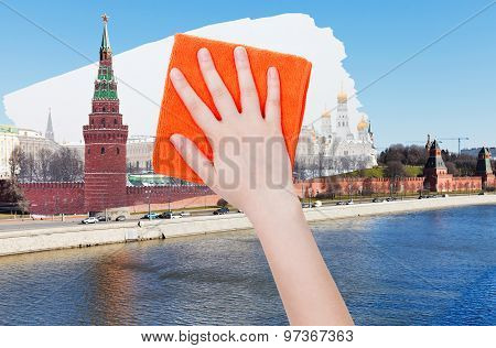 Hand Deletes Summer View Of Moscow By Orange Cloth