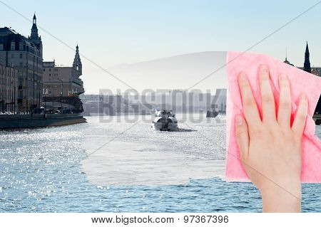 Hand Deletes Winter Moscow River By Pink Cloth