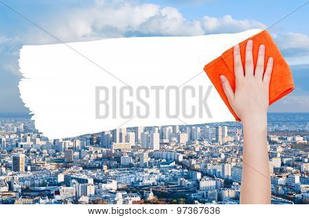 Hand Deletes Blue City By Orange Rag
