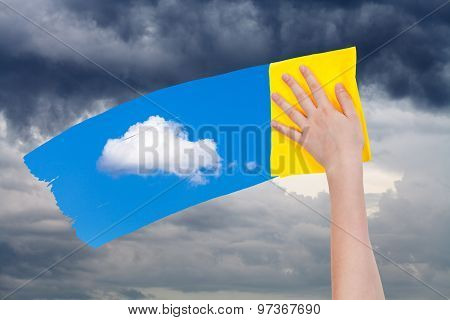 Hand Deletes Rain Clouds By Yellow Cloth