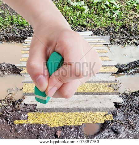 Hand Deletes Wet Road From Image By Rubber Eraser