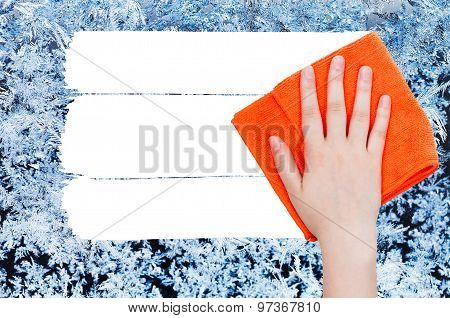 Hand Deletes Winter Frozen Texture On Glass By Rag