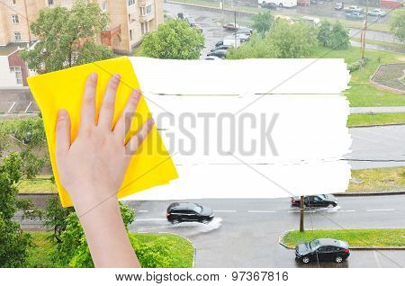 Hand Deletes Rain On Street By Yellow Rag