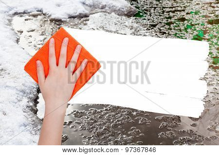 Hand Deletes Melting Snow By Orange Rag