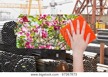 Hand Deletes Industrial Landscape By Orange Cloth