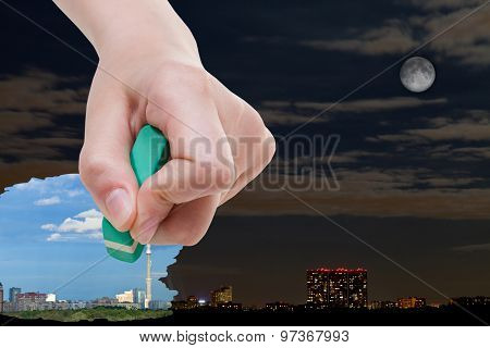 Hand Deletes Night Cityscape By Rubber Eraser