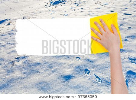 Hand Deletes Snow Surface By Yellow Rag