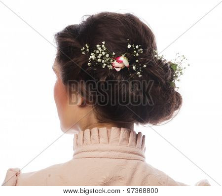 back view of beautiful haircut with small pink flowers