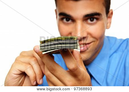 Young man with a wad of banknotes
